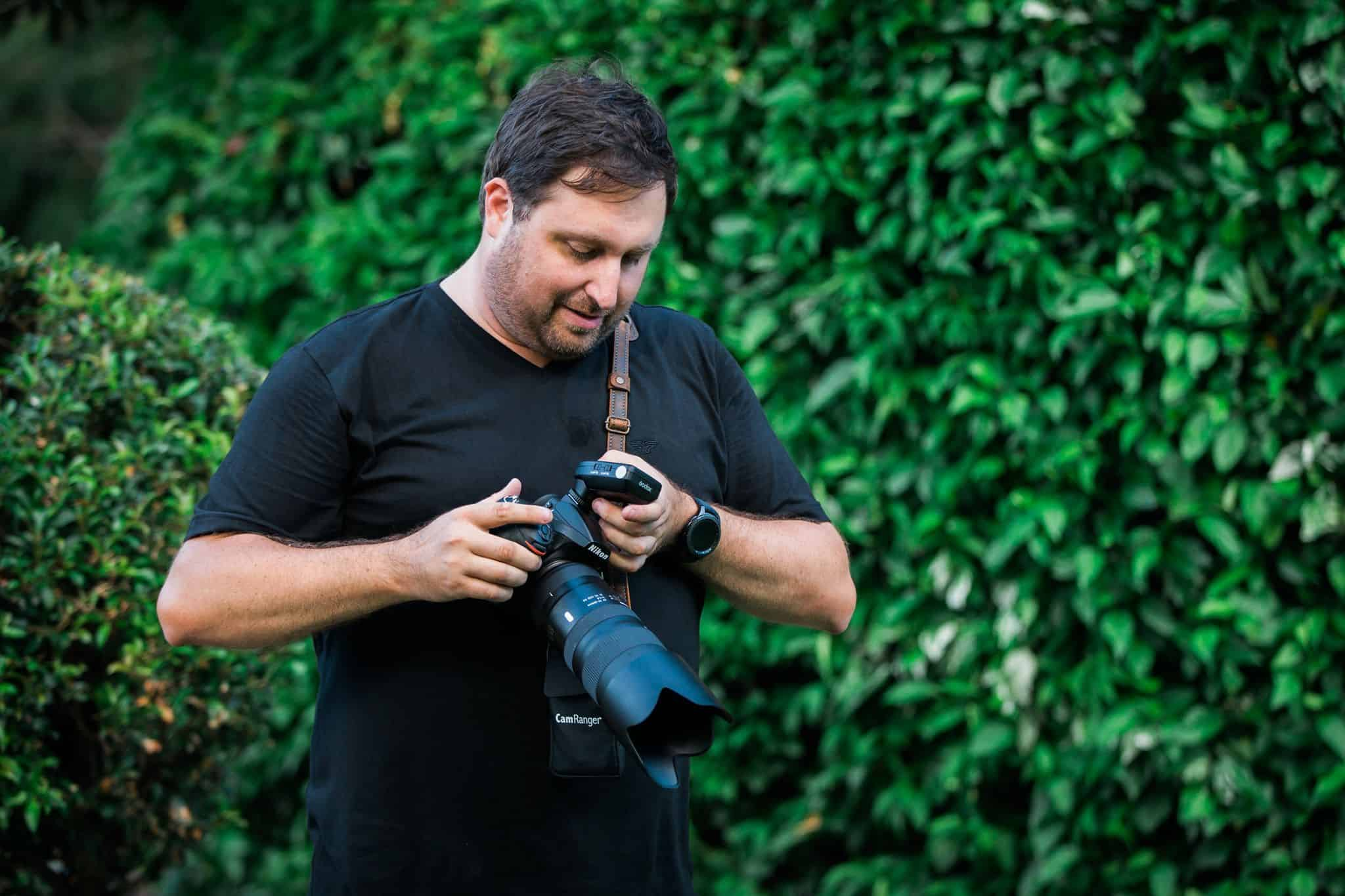 The owner of Crew One Photography operating his camera