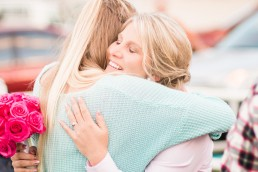 Calliope country bride hugs guest