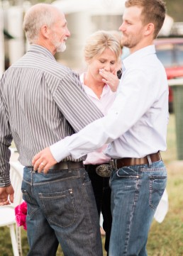 Emotional calliope country bride and proud father and son moment