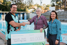 Gladstone South Swimming Club receive cheque from Telstra