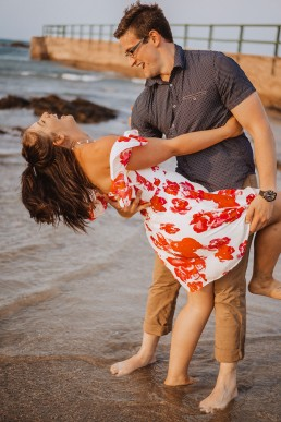 Engaged couple dance on the beach