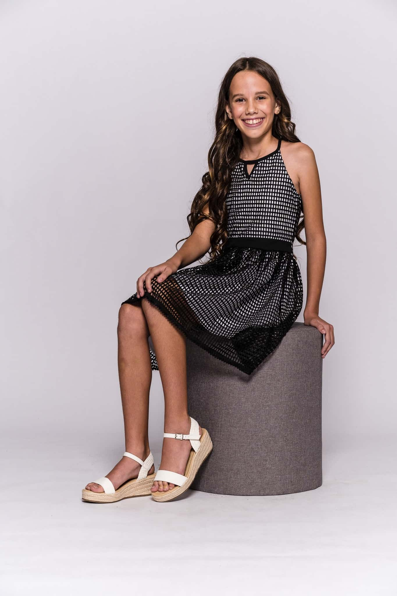 young model on stool