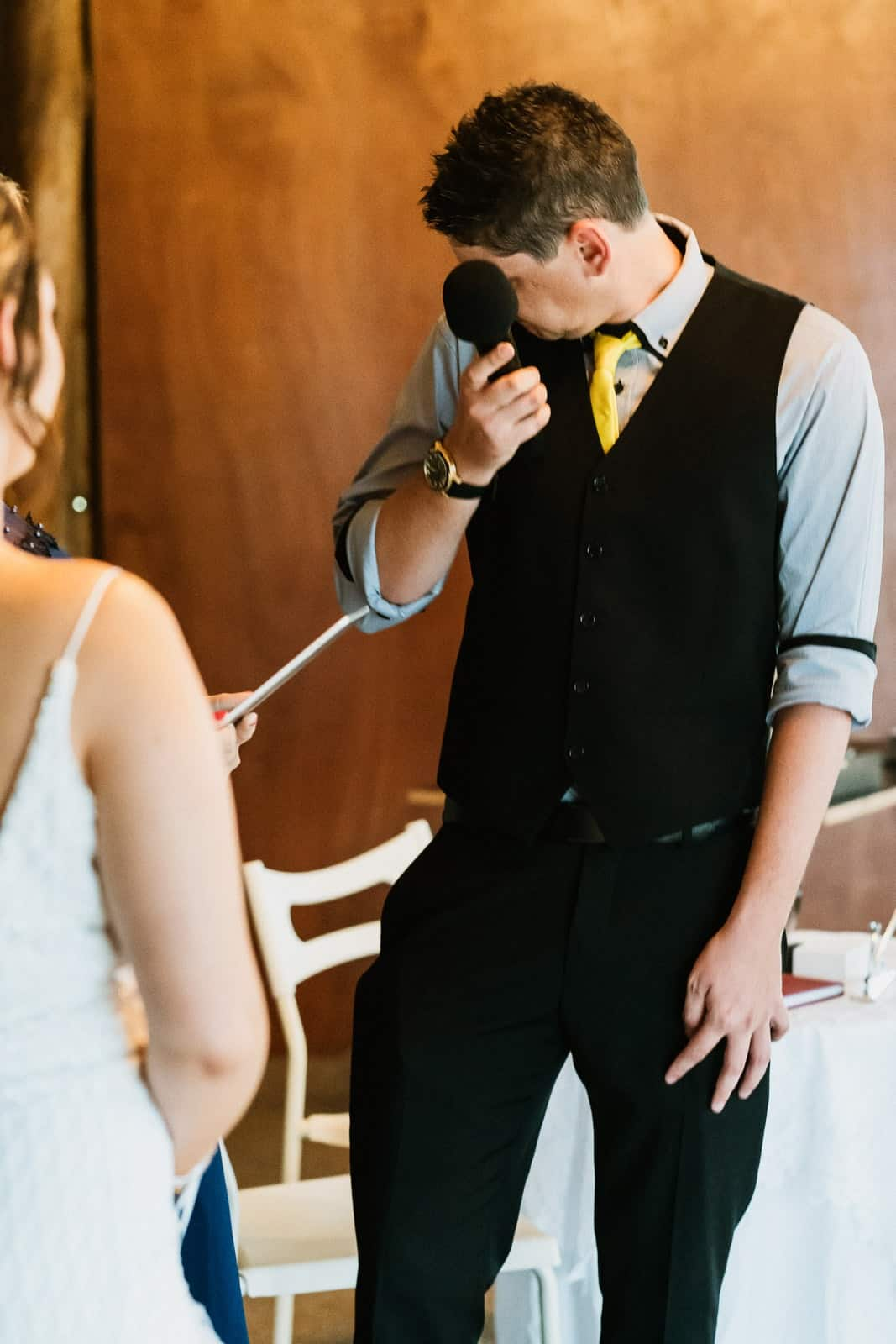 Groom wipes away tear