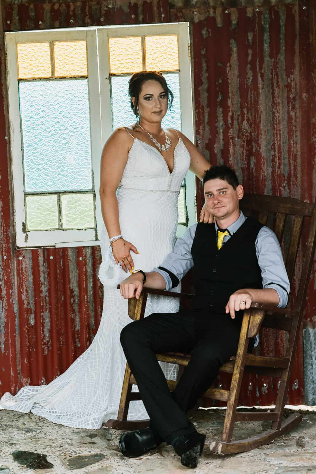 Wedding couple in old rocking chair