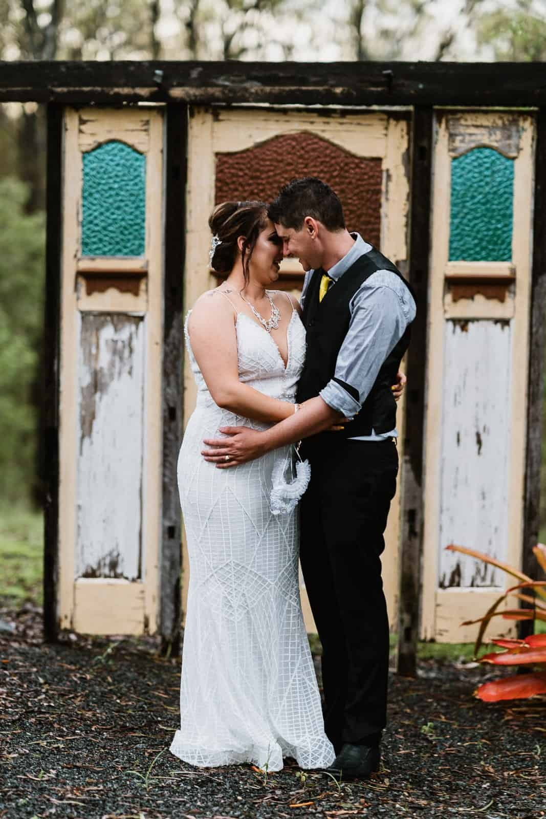 Wedding couple in front of old doors