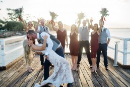 Bridal party celebrate bride being dipped