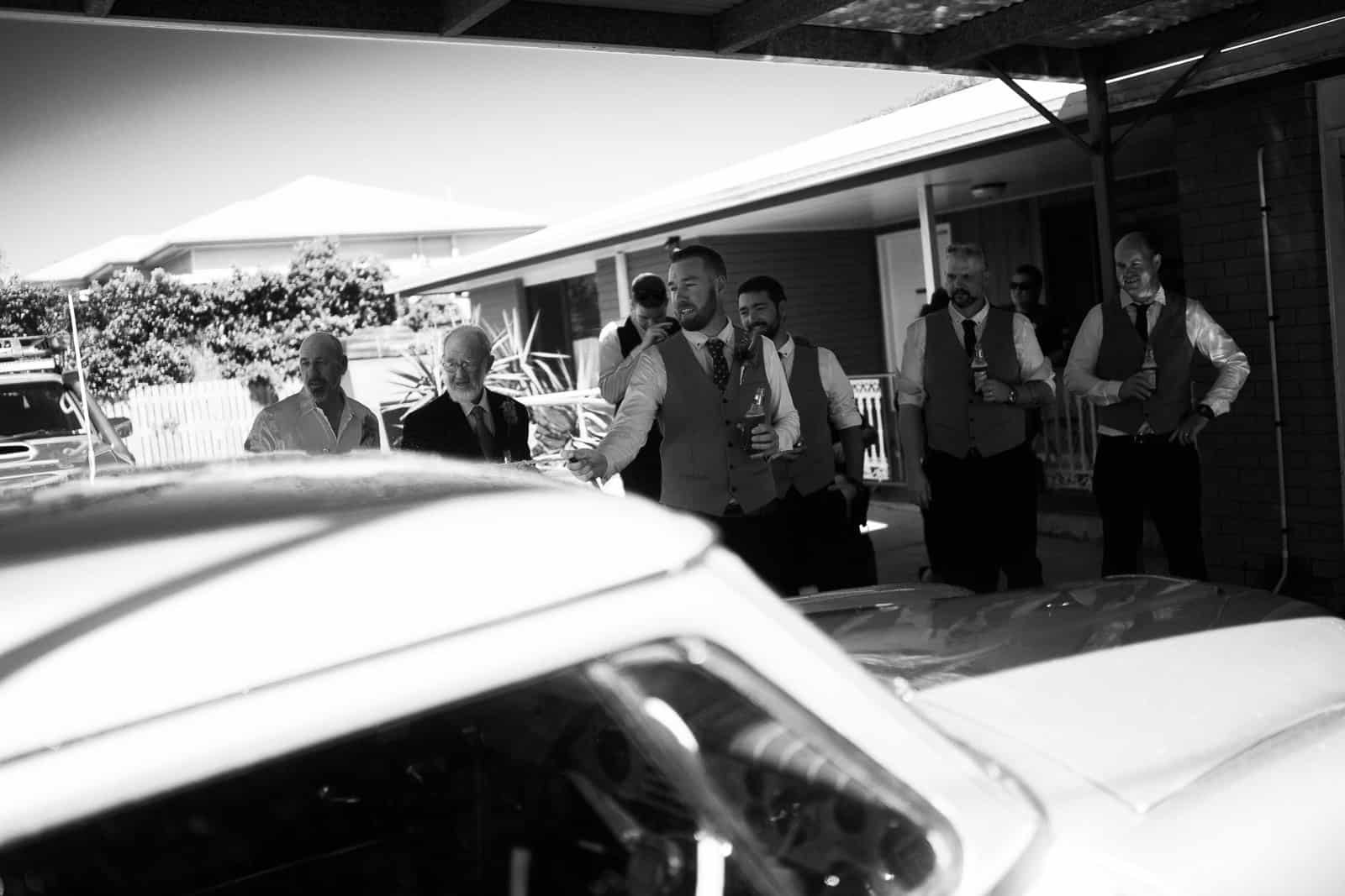 Groom washing wedding car