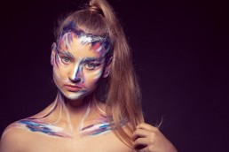 Model with a painted face