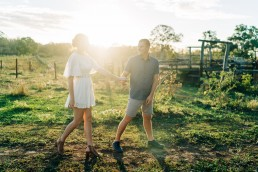 Couple in front of rural setting