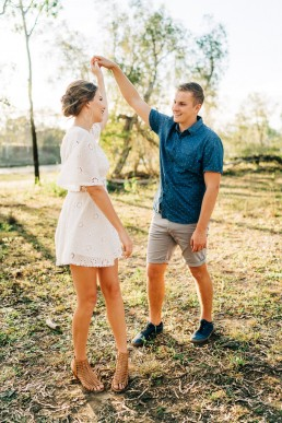 Engaged couple dance in the bush