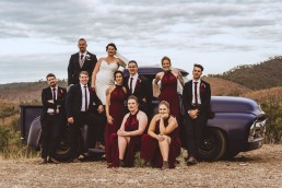 Bridal party on old truck at Old Station