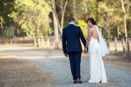 Bride & Groom on dirt road